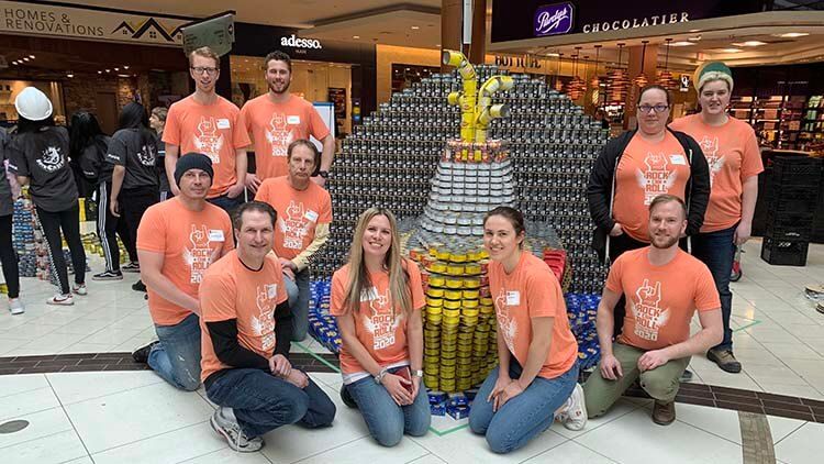 The 2020 Canstruction team with their structure,